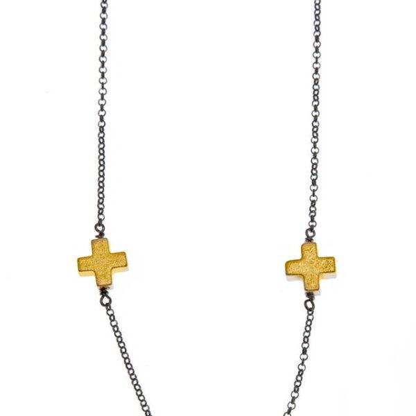 Κολιέ μαύρο με κίτρινους σταυρούς.